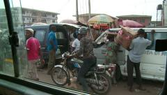 Hustle & bustle by road Nigeria #2 Stock Footage
