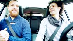 Two cool handsome men having fun laughing in car Stock Footage