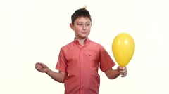 boy eats balloon with a needle and frightening explosion slow motion - stock footage