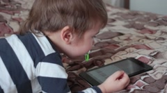 Child crawls to the tablet and turn it off Stock Footage