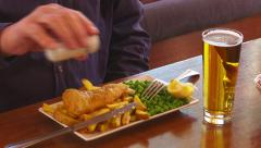 Hungry man eats fish & chips  Stock Footage