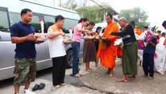Give food offerings to a Buddhist monk in Morning Stock Footage