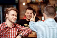 Client orders two glasses of beer Stock Photos