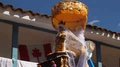 Statue with umbrella on Virgin del Carmen festival parade in Pisac(Peru) Stock Footage