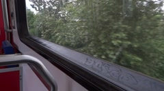 Subway Train Window - 01 - Trees and Buildings Stock Footage
