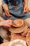 Sculpturing the clay pot Stock Photos