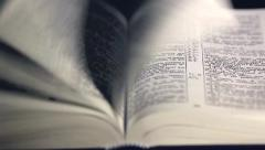 The Bible, the wind flipping pages. Stock Footage