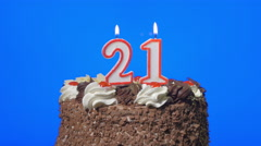 4k - Blowing out number twenty-one birthday candles on a delicious chocolate cak - stock footage