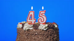 4k - Blowing out number fourty-five birthday candles on a delicious chocolate ca Stock Footage