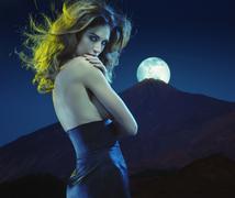 Seductive young lady at moonlight - stock photo