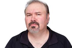 Puzzled middle-aged man with a goatee - stock photo