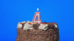 4k - Blowing out number four birthday candle on a delicious chocolate cake, blue - stock footage
