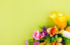 Floral arrangement on a yellow background Stock Photos