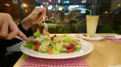 Stock Video Footage of Guy enjoying appetizing salad, eating out, having low-fat dinner