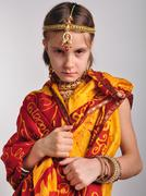 Gloomy little girl in traditional Indian clothing and jeweleries Stock Photos