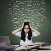 Anxious girl preparing for exam - stock photo