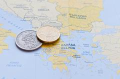 Greek Drachma and Euro cent on a Greek Map - stock photo
