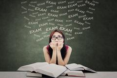Student feel scared of exam - stock photo