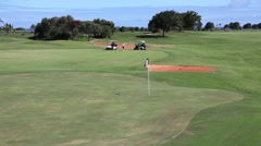 Lefty golfer hit a perfect shot on hawaiian golf course Stock Footage