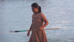 Young girl fishing lobsters and  sea food at sunset Stock Footage