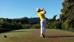 golfer hit is iron shot from the tee box in hawaii - stock footage