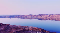 Beautiful view of lake Sandstone contrasting with the blue water - stock footage