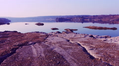 Red Stone coast near the lake Stock Footage