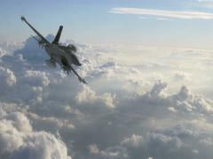 F-16 Fighter Jet Fast Pass Over Evening Clouds Stock Footage
