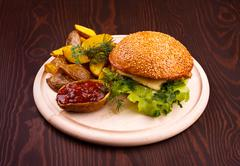 Hamburger on wooden board Stock Photos