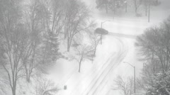 Car making right-hand turn during heavy snowfall Stock Footage