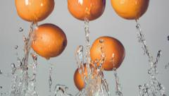 oranges are flying with a jet of water, slow motion - stock footage