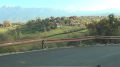 Driving shot inside a car moving on a mountain road in a holiday trip. - stock footage