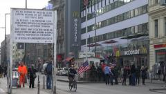 Checkpoint Charlie, Berlin, tourists pose Stock Footage