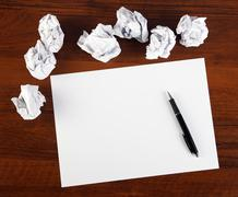 Blank paper with pen Stock Photos