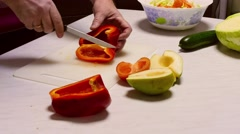 Cooking salad, Man slicing pepper for vegetable salad Stock Footage