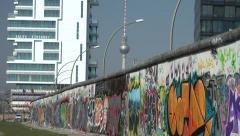 Berlin Wall, graffiti side facing former West Berlin. Stock Footage