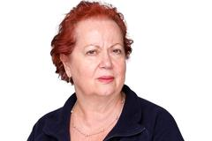 Perplexed senior lady with a puzzled frown - stock photo