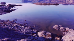 Ecological disaster on Lake with sandy orange purple dead sandy beach. Color Stock Footage