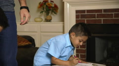 Little boy having fun coloring in a book Stock Footage