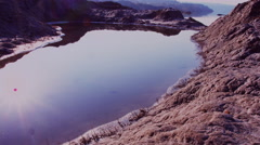 The water in a small crater near the Rocky Mountains on hot days Stock Footage
