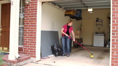 husband and wife doing spring cleaning - stock footage