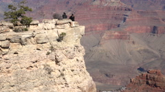 Grand Canyon tourists on edge of steep lookout 4K Stock Footage