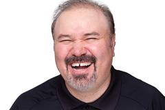 Middle-aged man enjoying a good laugh Stock Photos