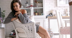 Seductive Woman Sitting on a White Chair Stock Footage