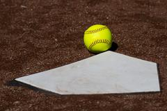 Fair Ball Yellow Fastpitch Softball Hits Homeplate - stock photo