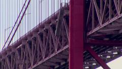 Red bridge deck, tower and suspender cable closeup Stock Footage