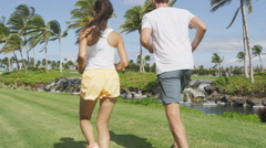 Jogging couple of runners running together in park -  Active summer lifestyle Stock Footage