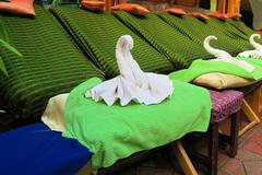 Thai Spa massage chairs with swan towel Stock Photos