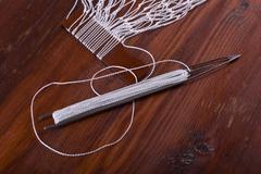 Shuttle for tying fishing nets - stock photo