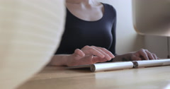 Women typing on keyboard and using trackpad - stock footage